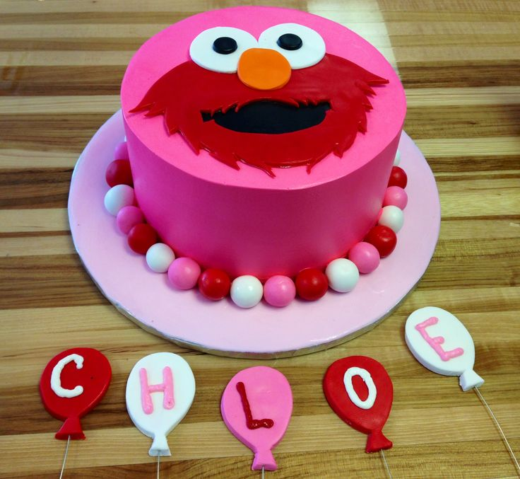 """Elmo girl cake, hot pink with fondant elmo head, """"Chloe"""" spelled out in balloons"""