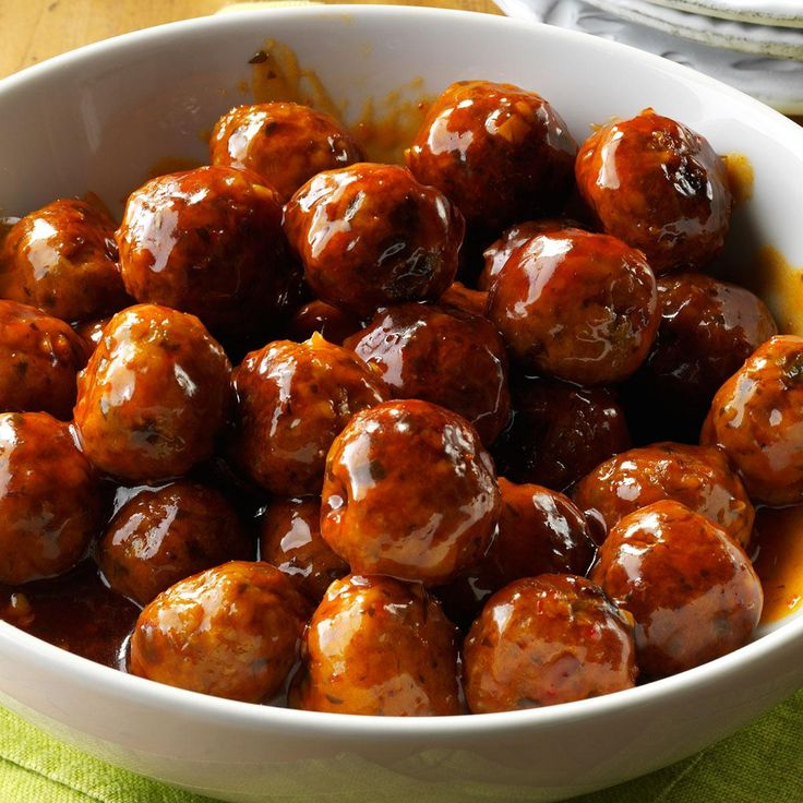 Sweet and Spicy Asian Meatballs Recipe -For holiday parties, I make glazed meatballs and deliver them in the slow cooker so they're spicy, sweet and ready to eat. —Gail Borczyk, Boca Raton, Florida