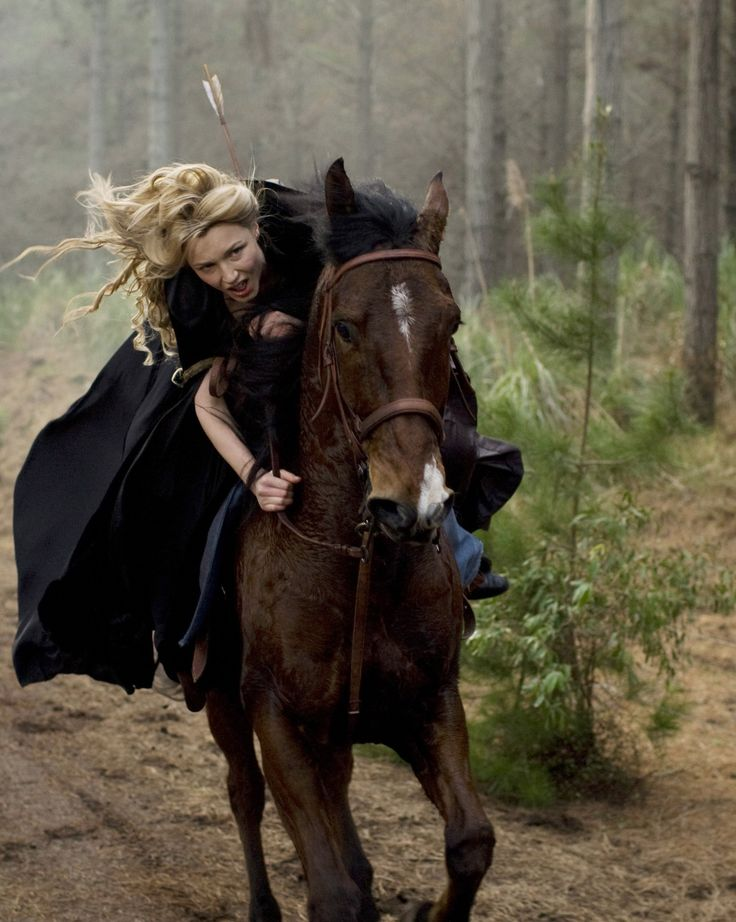 I wanna ride on a horse through a misty forest wearing a badass lookin cape and arrows across my back!!! :)