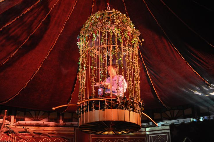 Dave Redman sits in cage high above the stage during the Clicks Madame Zingara beauty range launch at Madame Zingara at the V&A Waterfront.