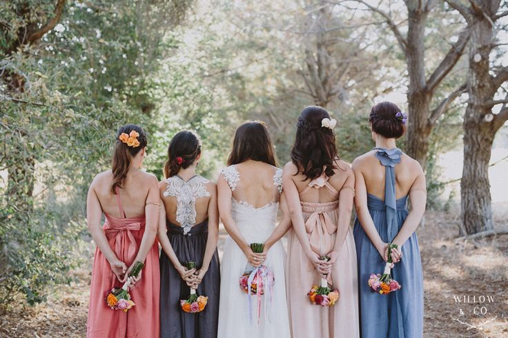 Mismatched Anna Campbell bridesmaid dresses.