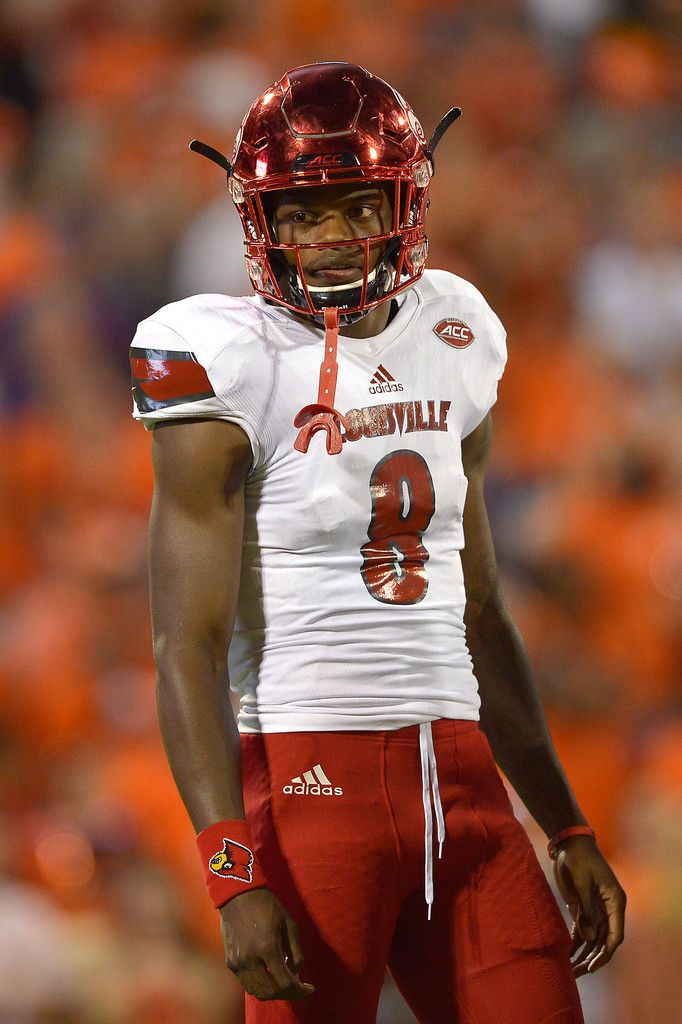 Lamar Jackson Photos Photos - Lamar Jackson #8 of the Louisville Cardinals looks on against the Clemson Tigers during the first quarter at Memorial Stadium on October 1, 2016 in Clemson, South Carolina. - Louisville v Clemson