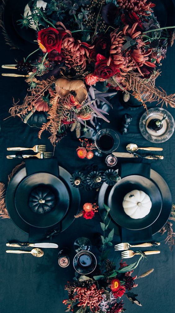 chic moody Halloween tablescape with bold florals