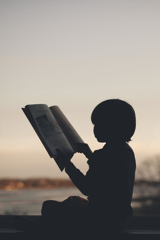 Love photos of children deep into thought reading or picture looking in their books.