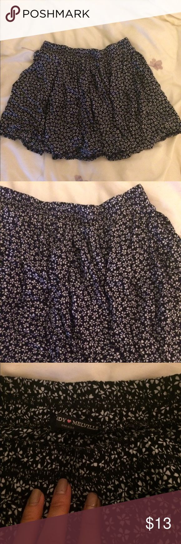 "Brandy Melville skirt Blue with white floral print. Super cute!! One of my favorite ones. Worn multiple times. It still in great condition. This one runs a bit short unfortunately. I'm 5'3"" and would not bend over in this. Brandy Melville Skirts"