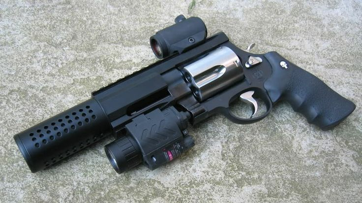 The custom black version of the Smith & Wesson Model 500 with a suppressed black barrel, a Knight's Armament RIS setup, flashlight, and laser sight - .500 S&W Magnum