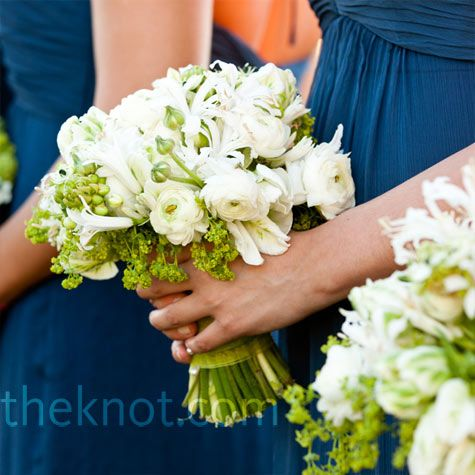 Navy blue dresses and all white bouquets.