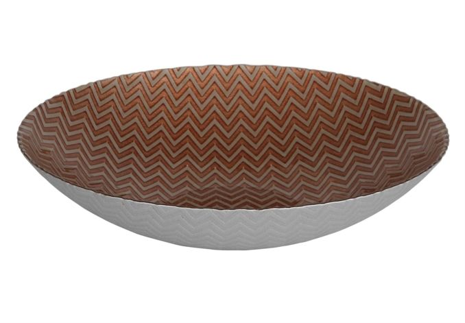 The outside of this beautiful glass bowl is pale in colour, textured with a subtle chevron design.  The same chevron pattern is echoed in a rich metallic patina inside the bowl, in a striking dark coral colour.  More than just a bowl, this lovely dec...