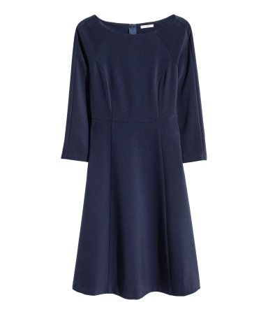 Dark blue. Knee-length, boatneck dress in thick woven fabric. Visible zip at back, long sleeves, seam at waist, concealed side pockets, and circle skirt.