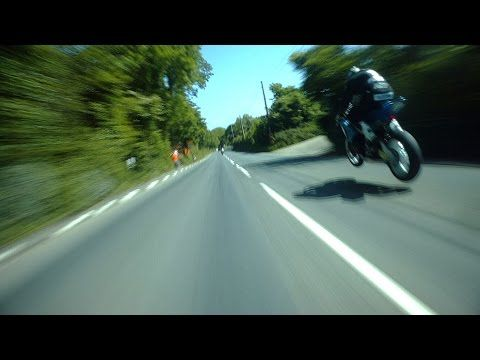 THE GREATEST SHOW ON EARTH: Like the Millennium Falcon travelling through hyperspace, Guy Martin chases 2014 Superbike division winner Michael Dunlop around the Isle of man TT course at speeds up to & above 200 miles per hour. Hang  on to yourself!
