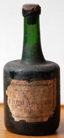 Vieux Rhum Anglais 1830  Caves du Grand Hotel Tirollier. Believed to be the oldest dated rum bottle yet discovered.