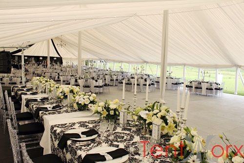Black and White themed wedding inside a peg and pole marquee tent.