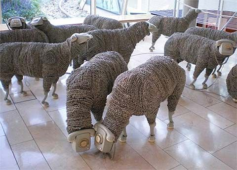 Jean Luc's sheep sculptures with vintage rotary telephone heads and earpiece feet.
