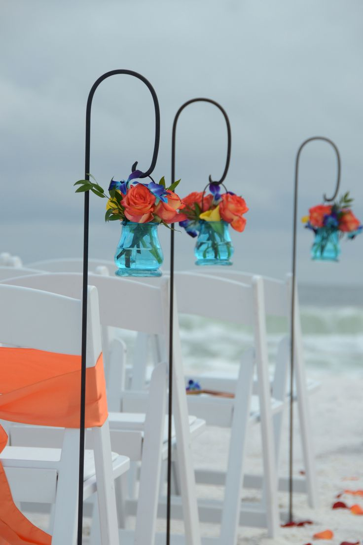 Shepherd's hooks with fresh tropical colored flowers add beautiful details to any beach wedding package. Bright colors turquoise and coral create a perfect scene for your walk down the aisle. Destin Beach Wedding, Panama City Beach Wedding, Florida beach wedding packages by Sunshine Wedding Company, Destin, Florida.