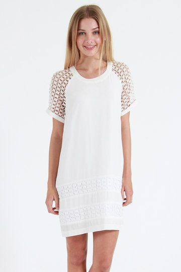 A life-long partner for your wardrobe, once you have Ketz-Ke's Clean Up Dress hanging in your closet, you'll never want it to leave. Crisp white and brimming with lovely, this angelic little cutie is straight and streamlined, with crochet sleeves and overlay along the bottom of the skirt.