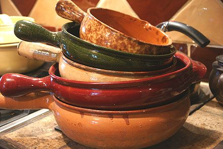 I've just started cooking in clay pots.  Here's a great article about several different styles of clay pots and their best uses.