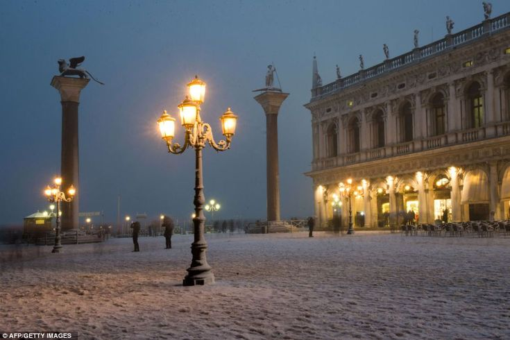 The heavy snowfall, which blanketed the city, including St Mark's Square, pictured, has added to Venice's weather woes