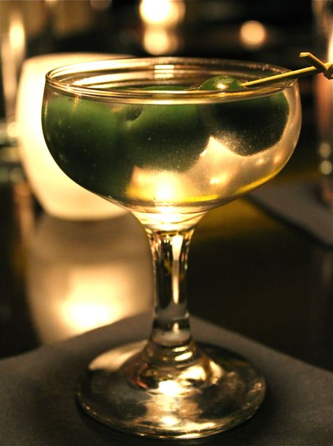 Eponymous martini from Bathtub Gin in NYC. Fords gin, Dolin dry vermouth, Queen Cerignola olives, and lemon oils, served up.