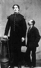 """Martin Van Buren Bates, known as the """"Kentucky Giant"""" among other nicknames, was a Civil War-era American famed for his incredibly large size.  Though born an infant of normal size into a family of normal-sized people in Letcher County, Kentucky, he is said to at one time have been 7feet 11 inches in height.   His ferocity in battle, aided by his imposing figure, made him legendary, with Union soldiers telling tales of a """"Confederate giant who's as big as five men and fights like fifty""""."""