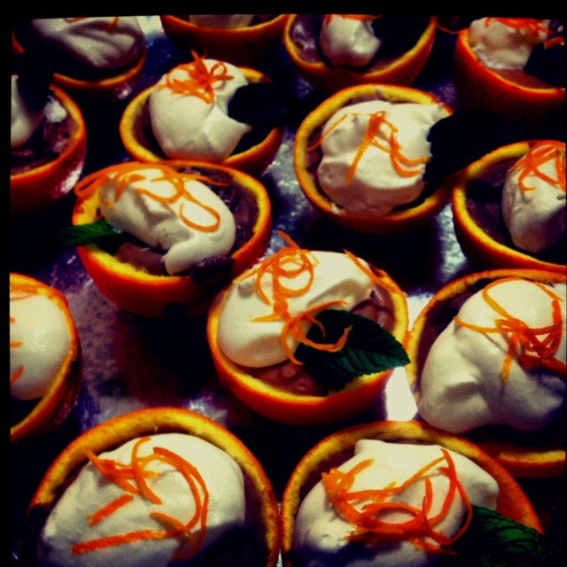 Halved oranges filled with chocolate mousse, topped with whipped cream. Heaven!