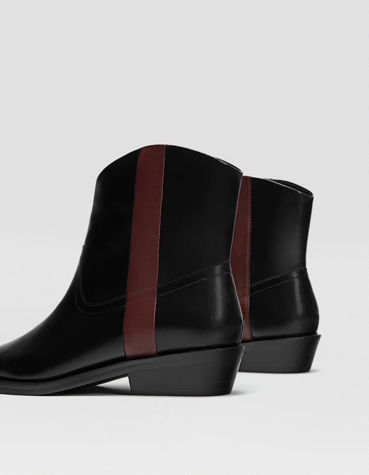 090f4b96 Botín cowboy negro PIEL - Botas y botines de mujer | Stradivarius ...