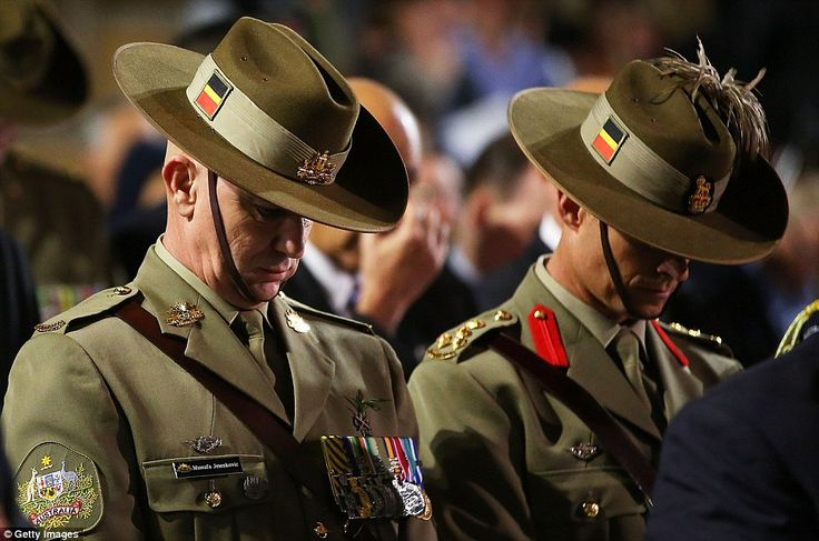 Servicemen stand in silence near the Cenotaph during the Sydney Dawn Service last year.