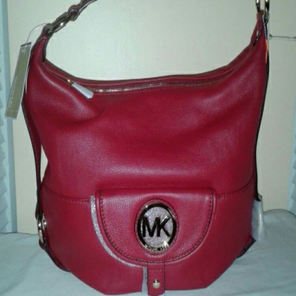 MICHAEL KORS HANDBAG $$ SALE $$ SALE Genuine leather handbag with zipper opening and single handle, ruby, gold medal and two outside compartments with four small inside pockets and one large zipper pocket, 16 x 13 x 7 Michael Kors Bags