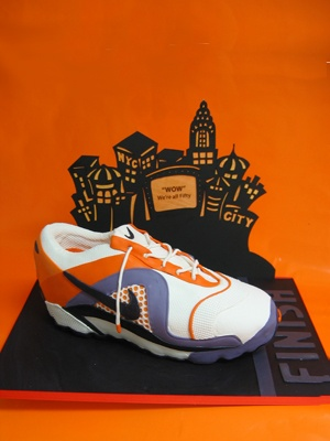 #Nike NYC Marathon Running Shoe Cake  Six layer #chocolate passion #cake filled with raspberry cream. Covered in colored fondant.