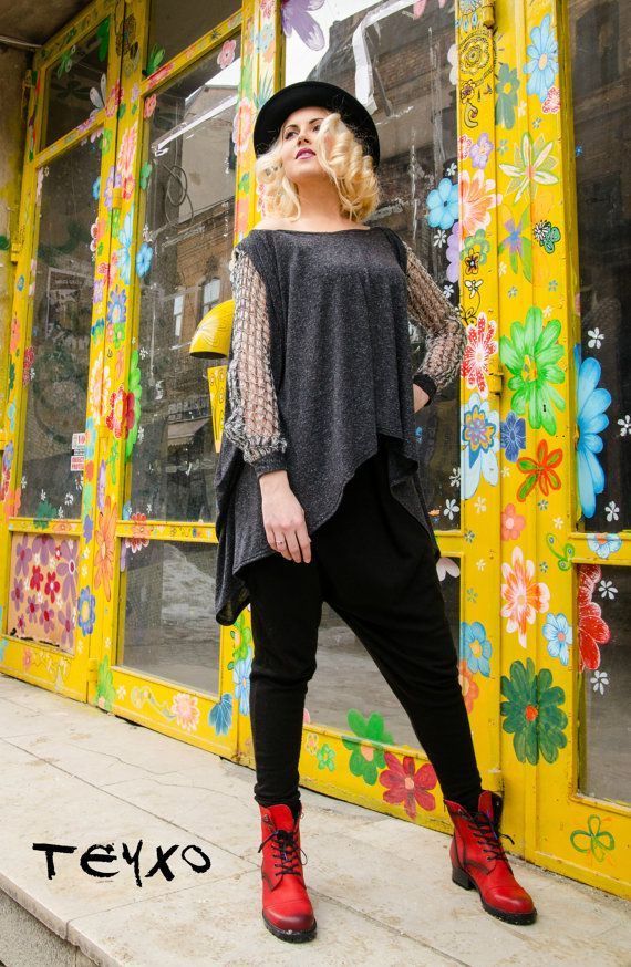 Plus size antrhacite tunic with sleeve crocheted acrylic yarn. Asymmetrical edge line.   Care instructions: 95% viscose, 5% full lycra. sleeves: 100% acryl Wash at 30 degrees  The model in the picture is size S.  Can be made in ALL SIZES.  If you have any other specific requirements, do not hesitate to contact me!  I DO NOT CHARGE EXTRA MONEY for custom made items.  All you need to do is send me your measurements. Below, you will find a table with size references.  How to get an accurate…