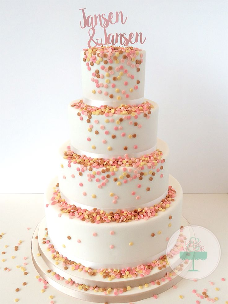 Confetti wedding cake with a personalized cake topper and confetti colors that matches the invitation!