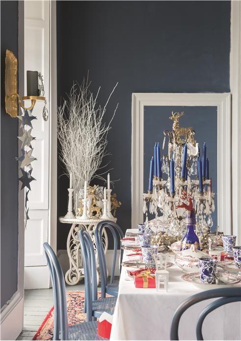 A festive dining room with walls in Stiffkey Blue Estate Emulsion, trim in Wevet Estate Eggshell and chairs in Stiffkey Blue Estate Eggshell.