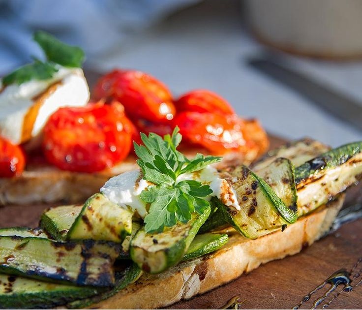 Crispy Italian style duo of bruschetta: Roasted tomato & buffalo mozzarella; char-grilled zucchini srizzled with balsamic glaze. #summer #bruschetta #zucchini #tomato #mozzarella #CafeParadiso