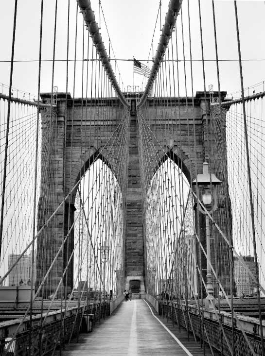Artist: J O H N   C H I A P P O N E Title: Brooklyn Bridge Medium: Photograph  This picture portrays balance by taking the scene and cutting it in half. Other than the people in the background the picture would be completely balanced. I choose it because I think it is a beautiful picture.