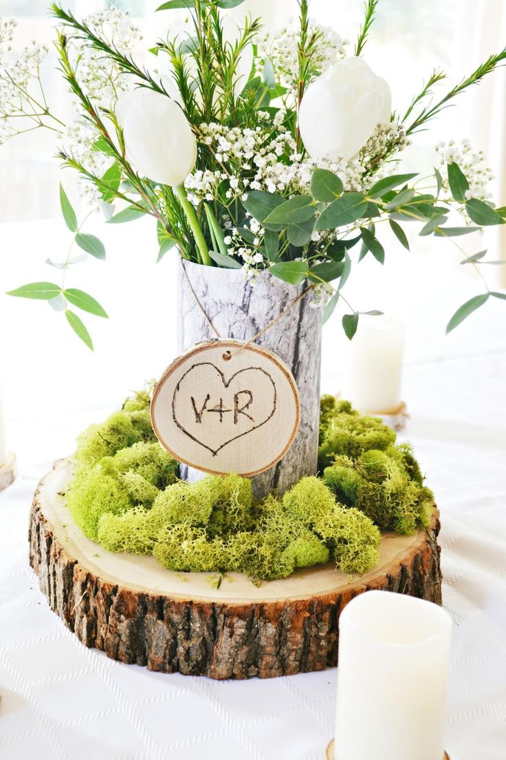 Engraved Wood Rounds And Moss Combine To Create A Simple But Elegant  Wedding Centerpiece With A