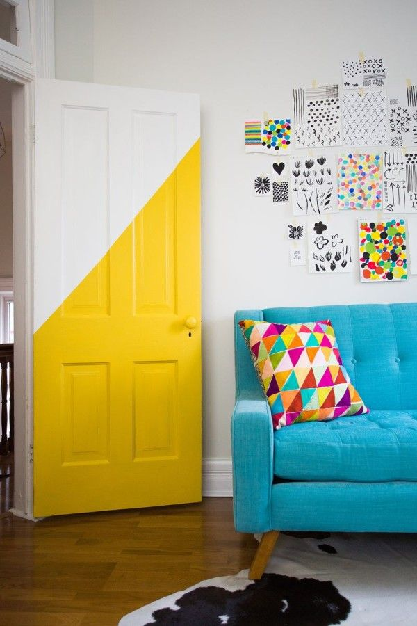 Partially bright yellow door creates a striking focal point
