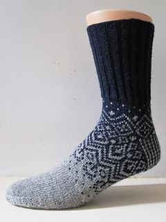 A design inspired by Scandinavian sweater construction, namely the stranded yoke style where decreases are masked by the pattern.