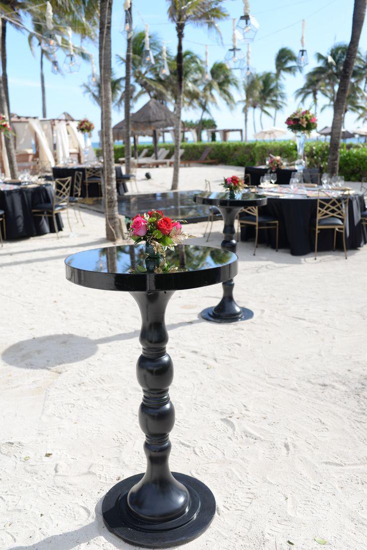 Simple black cocktail tables with #rosecenterpieces here at Dreams Tulum Resort & Spa! #Black&GoldWedding #BeachWedding #DestinationWedding