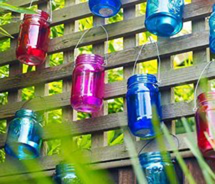Paint Glass Jars, wrap wire around top, make hanger, hang on fence for tea light candle holders