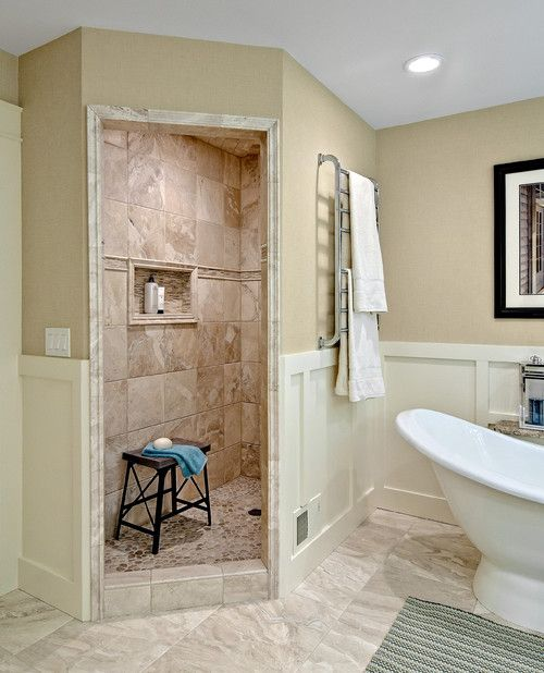 This bathroom makes its walk-in shower stand out with a shabby chic appeal. Photo by Design By Lisa