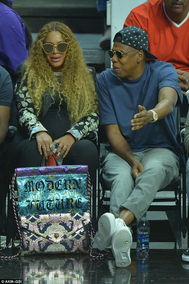 Pregnant Beyonce and Jay Z share tender moment at basketball game #dailymail