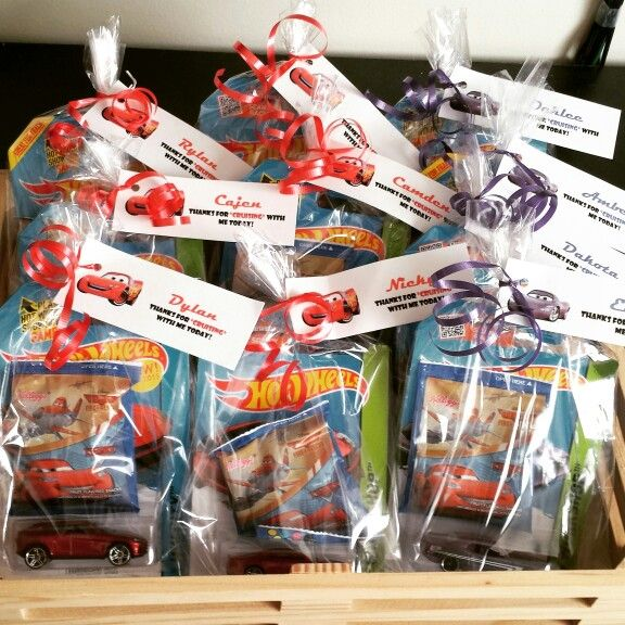 Party favors: hot wheel and fruit snacks. I did all red for the boys and purple for the girls to avoid tears/fights over colors.