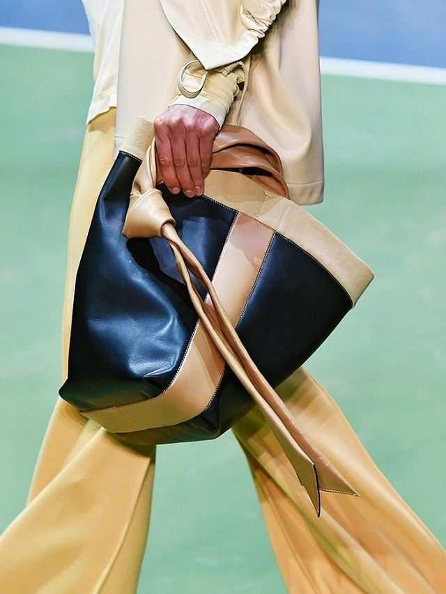 Céline Not only are subtle statement separates key, so are accessories. We predict this neutral, colour-blocked,knotted-handle shopper from Céline will be a key choice for...