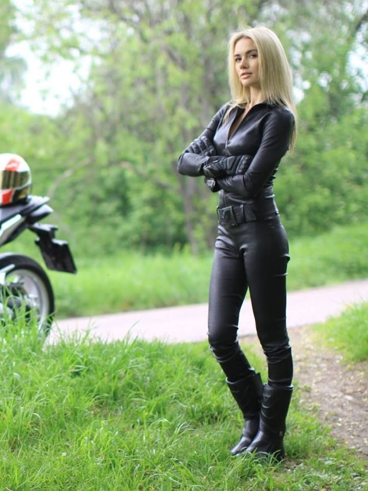 Blonde in black leather motorcycle riding outfit