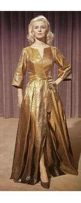 "Joanne Woodward in ""From the Terrace (1960) wearing a silk brocade hostess gown by William Travilla."
