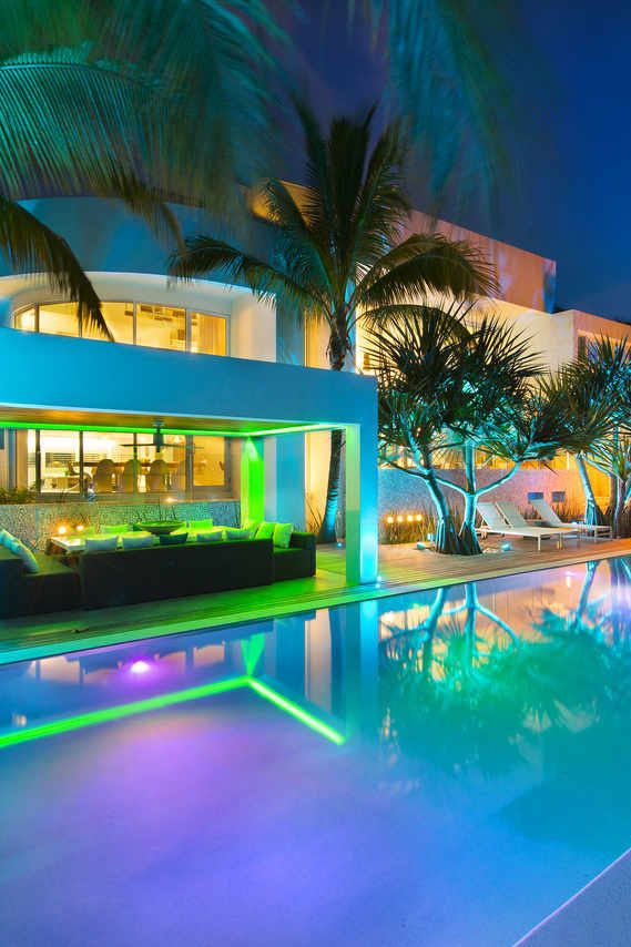 Neon Lighting Does Something Magical To A Nighttime Pool Setting.