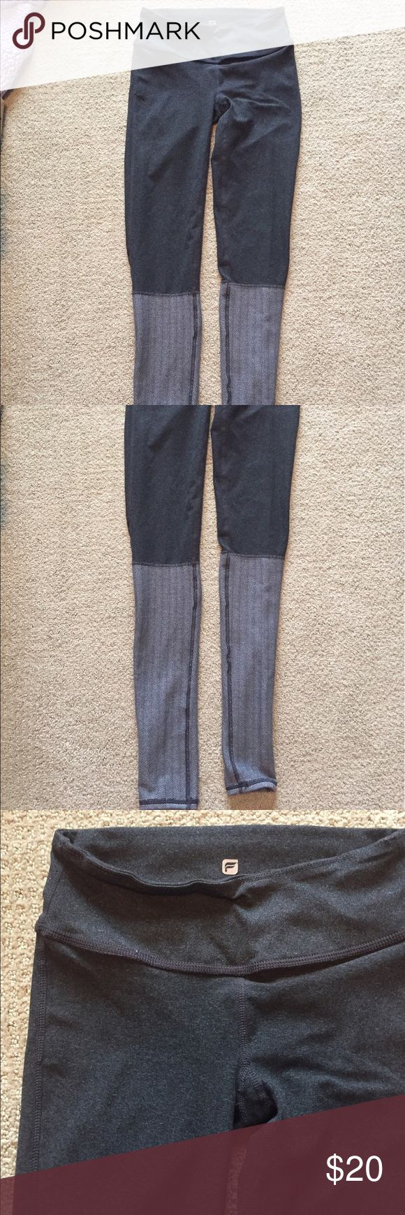 Fabletics two tone gray leggings. Two tone gray leggings with a herringbone pattern on the bottom half from fabletics. they are gently used but in great condition! there's no size on them, but they fit like an extra small. Fabletics Pants Leggings