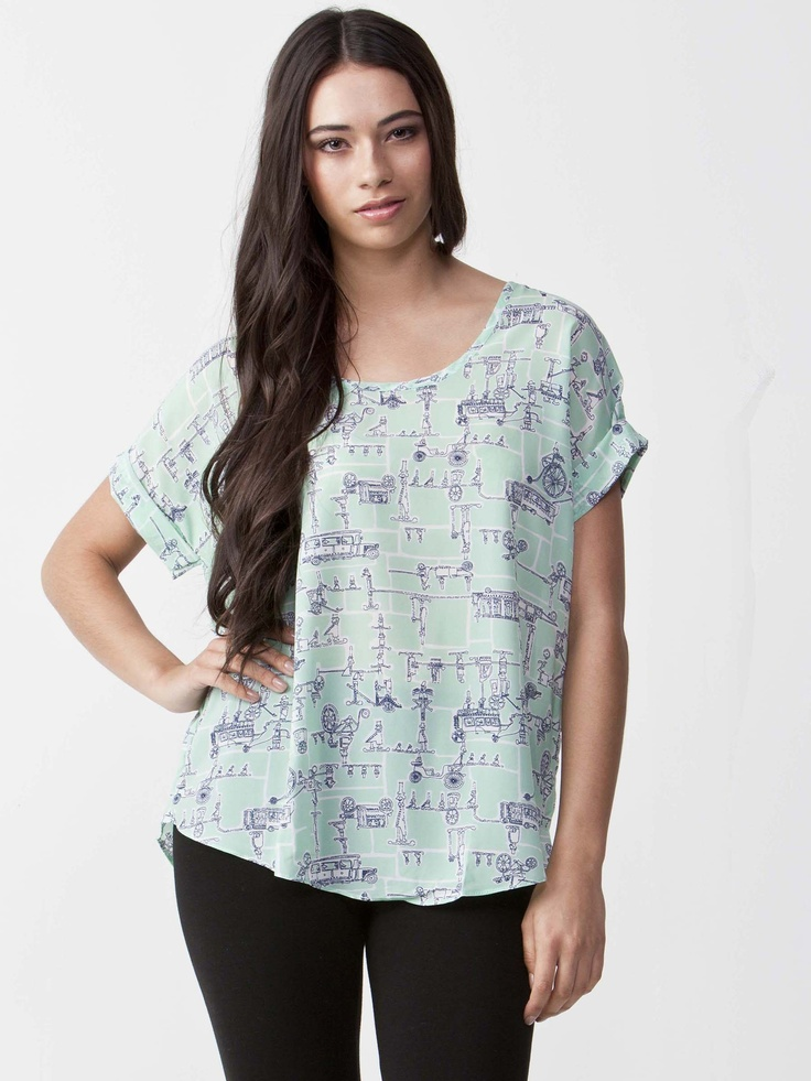Tiffany - Graphic Printed Top with round neckline. Folded short sleeve styling with loose fit. Regular cut and light graphic print. $44.00