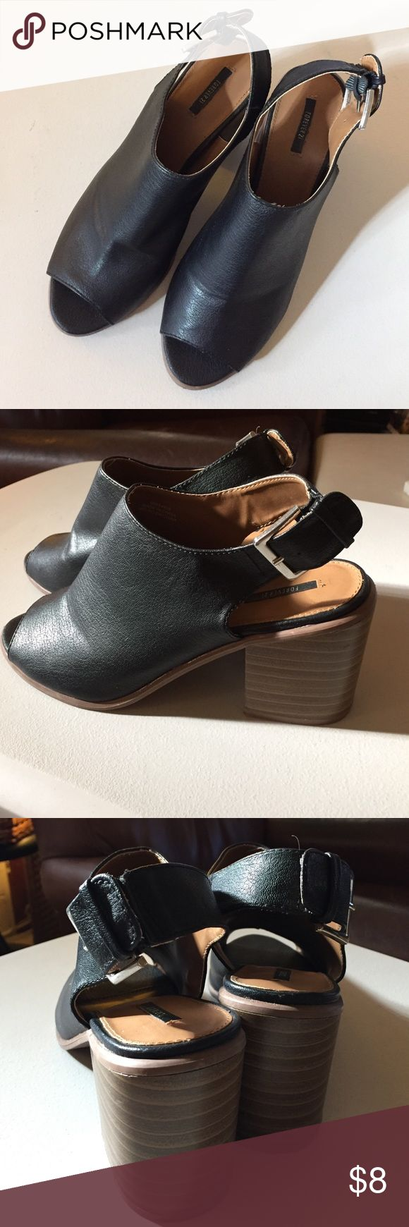 Forever 21 Chunky Heel Sandal Forever 21 Chunky Heel Sandal. Black faux leather uppers with silver colored buckle. Adjustable three hole strap. Chunky dark brown rubber heel that has some weight to it. A few light scuffs on the instep and heel, but no major issues. Forever 21 Shoes Sandals