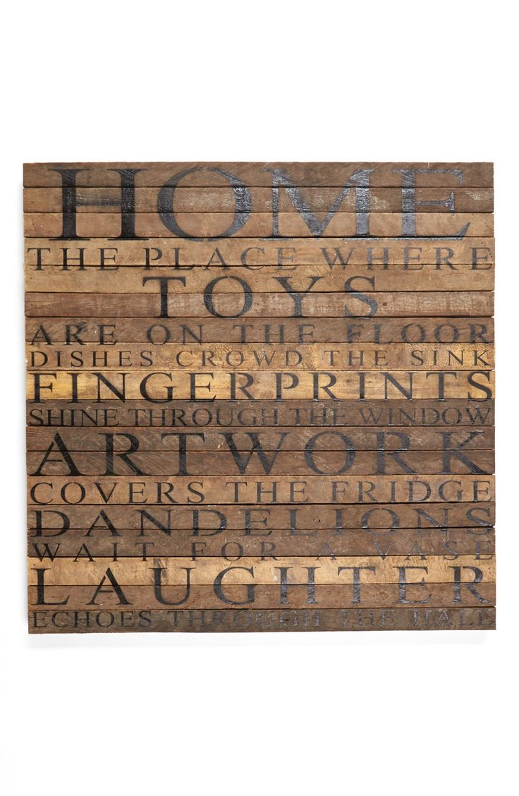 "- A rustic wall plaque, handcrafted from 100-year-old tobacco-lath wood salvaged from Wisconsin farms, is stenciled with a warm, joyful celebratory sentiment: ""Home: the place where toys are on the fl"