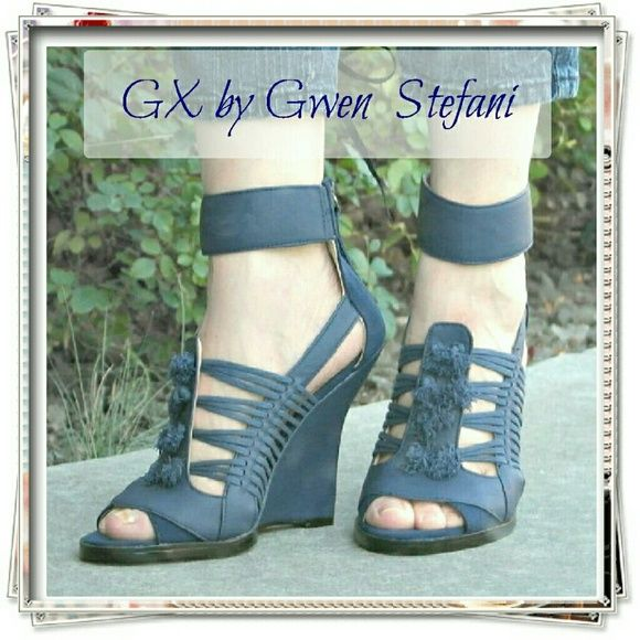 "GX by Gwen Stefani Ayaka wedge. Bohemian shoe with an edgy twist. The sculpted wedge features knotted cord details, beautiful shade of blue, and strappy look. Soft faux leather and faux nubuck.  Details: heel 4-1/2"", the sole is pretty thick, it makes the heel 4-1/4"". Runs narrow. Comfy!  Please use only ✔OFFER  button for all price negotiations. I'll do a price drop⤵ for you for discounted shipping, if we agree about the price. Shoe Dazzle Shoes Sandals"